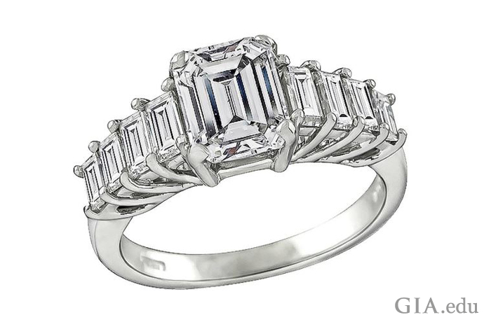 A 1.79 ct emerald cut engagement ring flanked by 0.70 carats of baguette cut diamonds