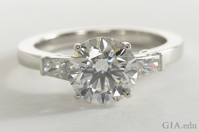 Tapered baguette diamond engagement ring with a 2.30 carat (ct) round brilliant center stone