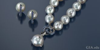 Semi-round South Sea cultured pearl necklace with blue sapphire accents