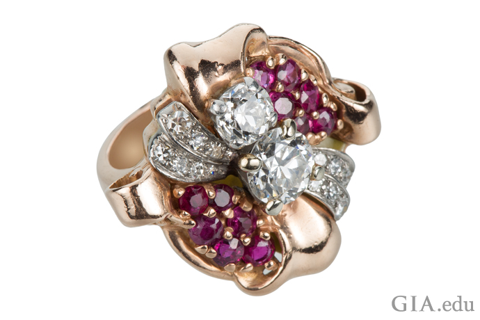 Rubies make for a colorful counterpoint to the 2 carats of diamonds in this Retro-era vintage engagement ring.