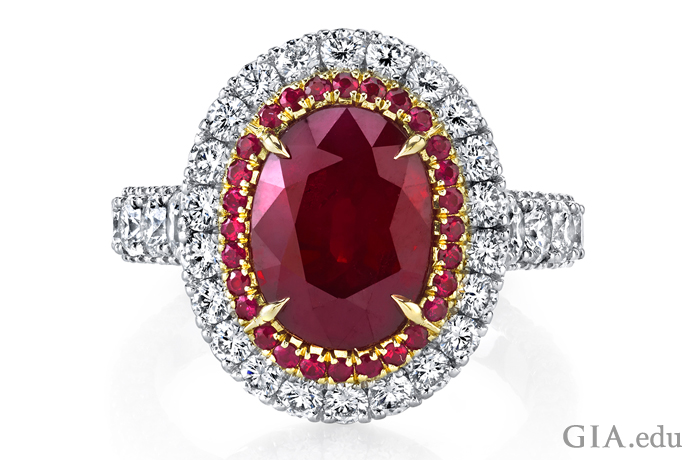 5.00 ct oval ruby is all the more radiant set in 18K rose gold and encircled by 2.53 carats of round diamonds in the halo and band.