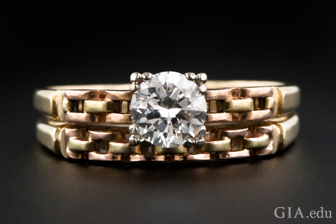 "Gold ""tank treads"" are the dominant motif in this vintage engagement ring and wedding band from the Retro period."