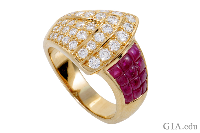 In this 18K gold contemporary re-creation of a Retro-style ring, approximately 0.90 carats of diamonds fan out to meet a field of invisibly set rubies totaling 2.23 carats.