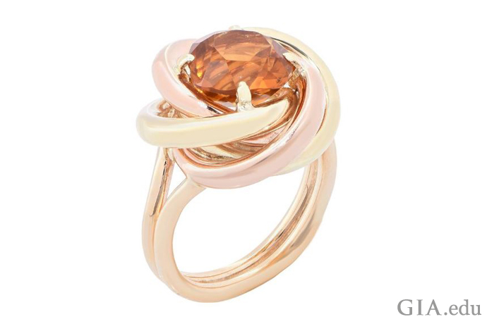 "A Cartier creation of the 1940s, this ""Love Knot"" ring features a citrine surrounded by both rose and yellow gold."