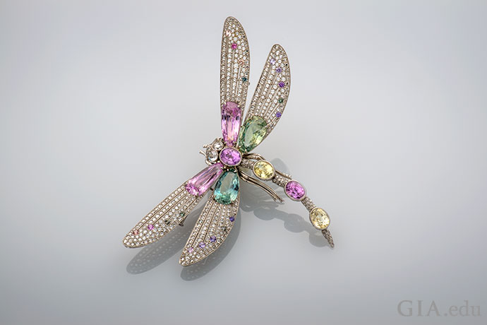A dragonfly brooch studded with a 38.82 carats of pink, green, blue and yellow fancy sapphires and 5.74 carats total weight of diamonds.