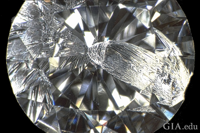 This 1.05 ct diamond has a chip starting at its girdle that extends to the culet.