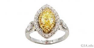 A 1.10 carat marquise yellow diamond engagement ring