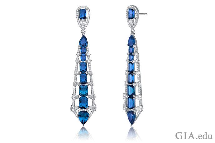 这些耳环坠子即为蓝宝石。 它们在20世纪20年代和30年代的装饰艺术时期非常流行,您的订婚戒指也可采用这种风格。