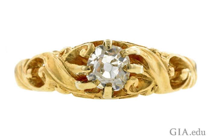 This gold Art Nouveau ring, circa 1900, is set with an old mine cut diamond that weighs 0.48 carat (ct).