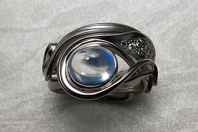 A moonstone is the centerpiece in this modern ring, which was inspired by the Art Nouveau era.