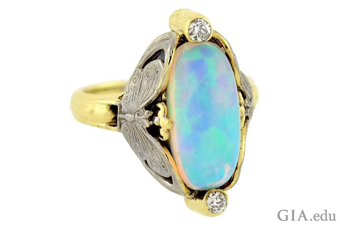The opal in this vintage Art Nouveau ring (circa 1910) displays play-of-color in hues favored by jewelry designers of the era.