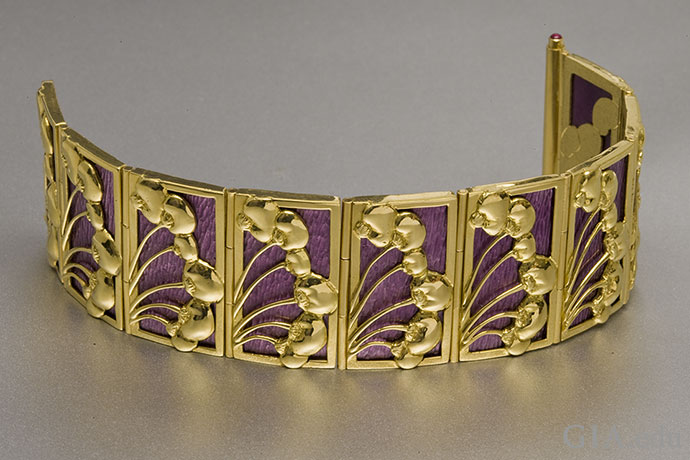 This striking bracelet may be modern, but its rich purple basse-taille enamel adorned with yellow gold cherries evokes the Art Nouveau era.