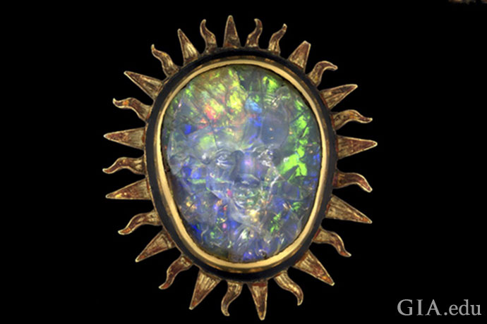 Believed to have come from Mexico in the 16th century, the Sun God Opal has a face carved into it.