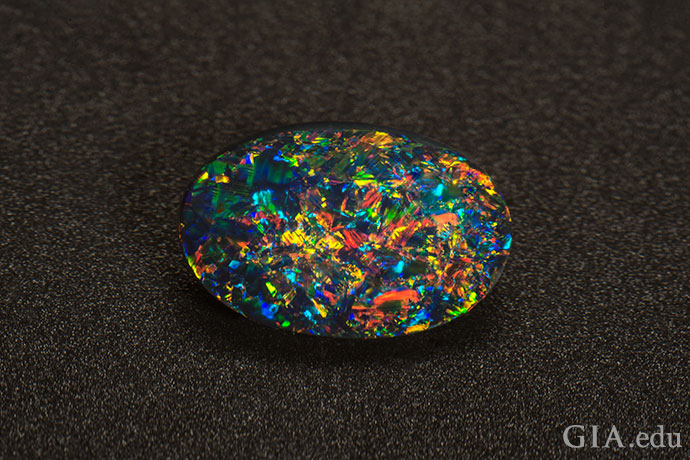 A gem-quality black opal displaying pinfire play-of-color.
