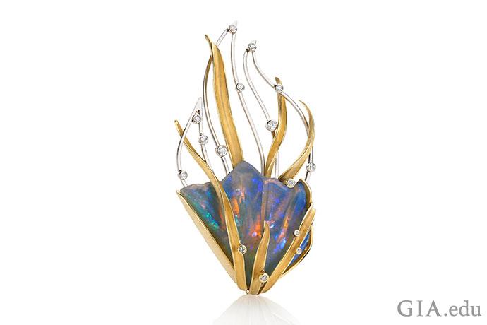 "Barbara Heinrich(芭芭拉·海因里希)打造的这枚胸针将蛋白石变成了一件艺术品。 这件作品完美诠释了""火彩""一词。"