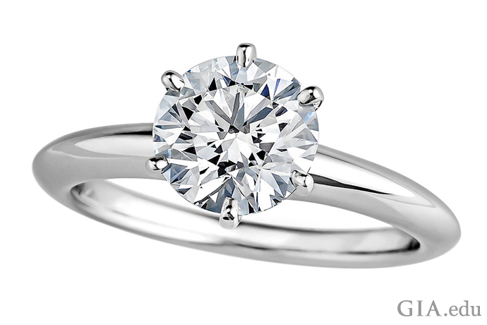 1.37 carat (ct) diamond is secure in a six-prong setting.