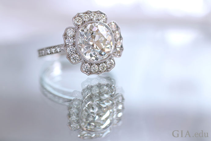 This modern engagement ring with its floral inspired design evokes the romantic Victorian period.