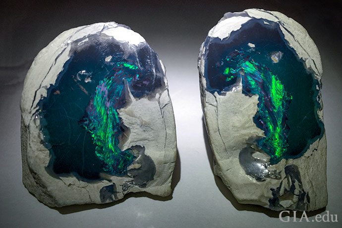 This black opal rough displays an obvious play-of-color, so it is considered precious opal.