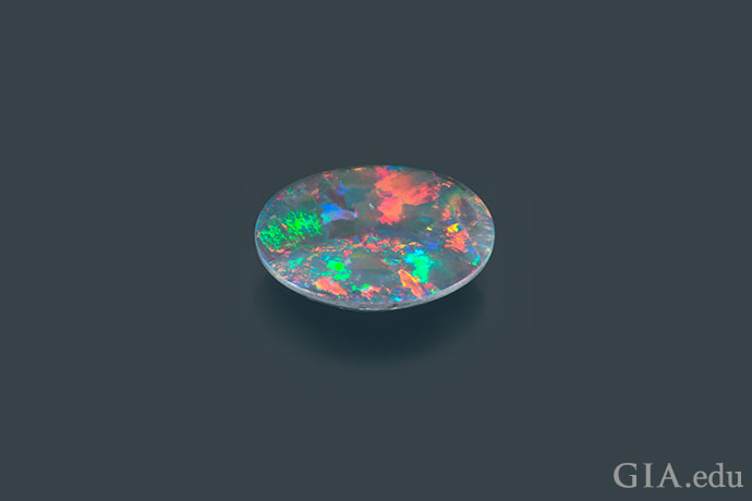 A breathtaking sunset seems to dance on the surface of this 1.72 carat (ct) opal from Lightning Ridge, Australia.