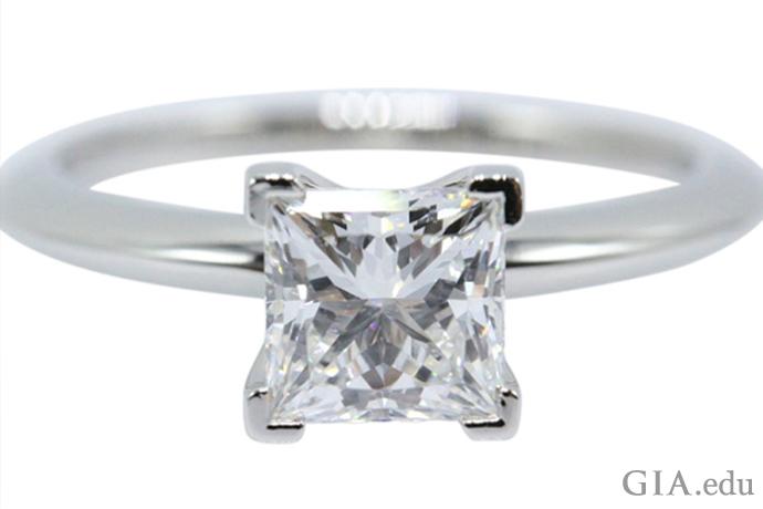 Princess cut diamond with V-shaped prongs.