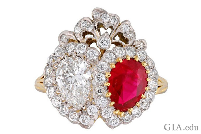 Two hearts beat as one in this Victorian-era ring, which features two stunning pear shapes, a 0.84 ct diamond and a 1.28 ct ruby.