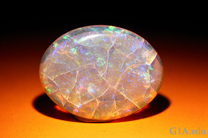 Loss of moisture may cause crazing in an opal. The cracks resemble a spider's web.
