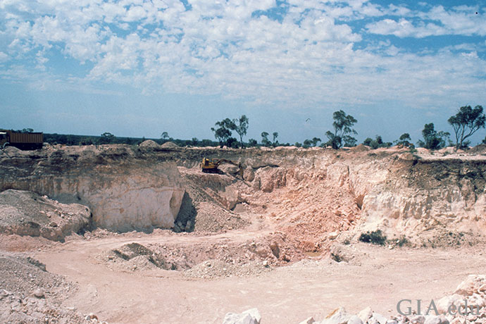 An opal mine is encircled by the stark landscape of Lighting Ridge.