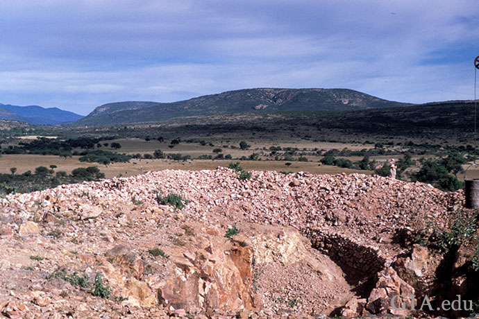 An opal mine in Querétero is in the foreground; a rugged vista is the backdrop.
