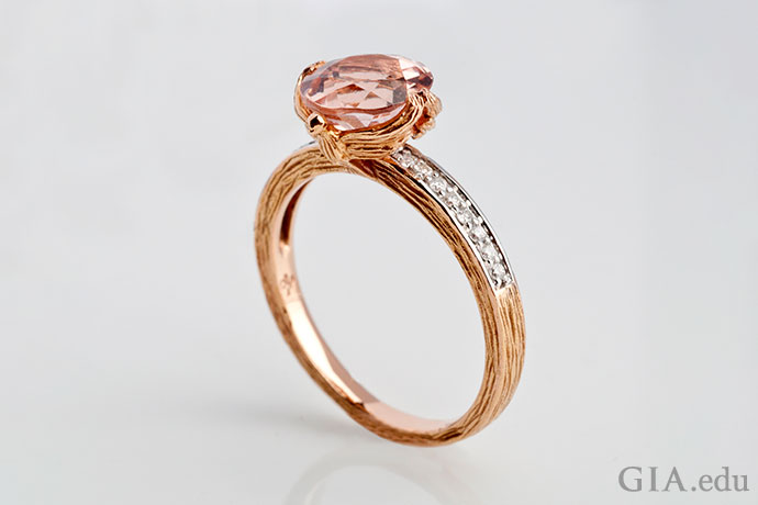 "Loretta Castoro's ""Love Doves"" ring has a 2 ct round morganite accented with diamonds in the shank."