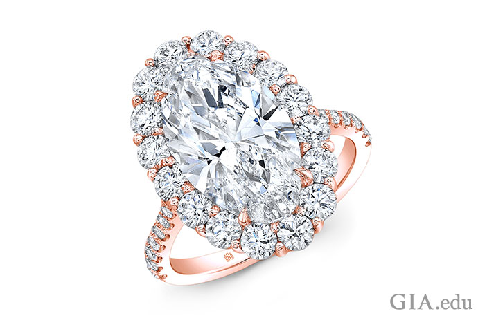 A 5.31 carat (ct) oval diamond set in a rose gold engagement ring setting.