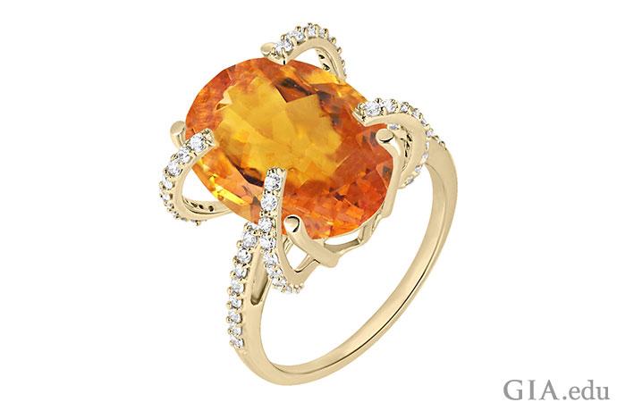 一枚镶嵌着黄水晶和钻石的18K黄金戒指。