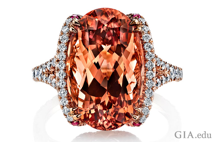 An 11.11 ct Imperial topaz ring accented with 0.29 carats of rubies and 0.75 carats of diamonds, all set in rose gold.