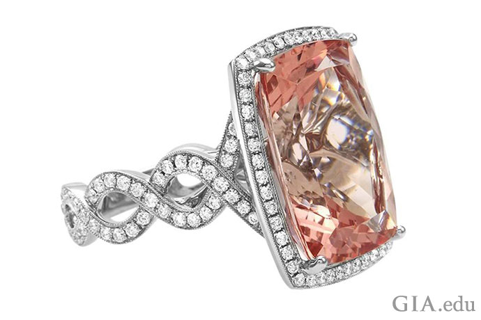20.03 ct morganite ring. Decorating the halo and band are 1.07 carats of diamonds.