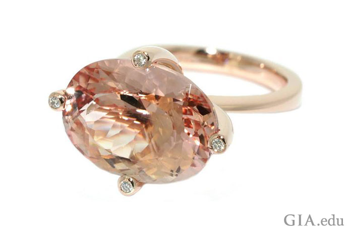 This 10 ct oval morganite makes quite a fashion statement set horizontally in the trendy east-to-west style. The 18K rose gold setting includes four diamond accents in the prongs.