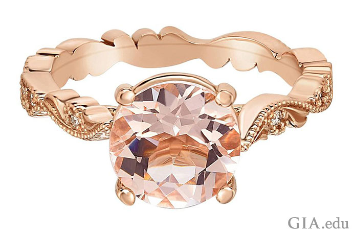 It's easy to fall in love with this charming morganite engagement ring. It features a 1.69 ct morganite and 0.08 carats of diamonds decorating the shank.