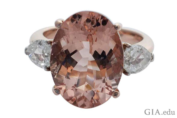 Placing a diamond on either side of the central gem is another way to add diamonds to a morganite engagement ring. Here, an 8.68 ct morganite is framed by two pear shaped diamonds weighing a total of 0.40 carats.