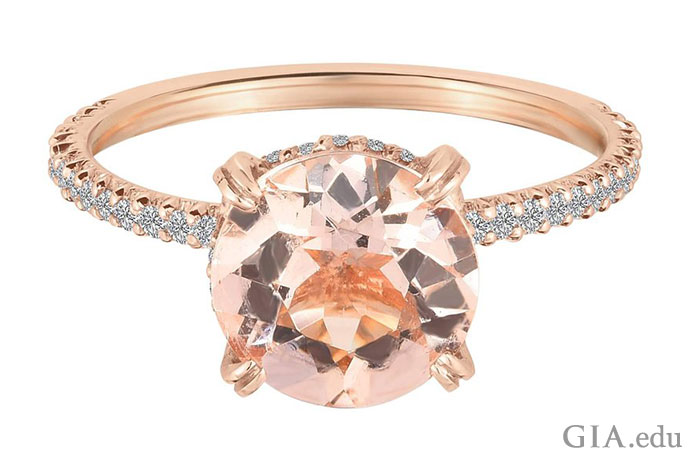 A solitaire is said to symbolize love, commitment and fidelity. This round morganite solitare set in rose gold brings the power of pink to a traditional engagement ring style.