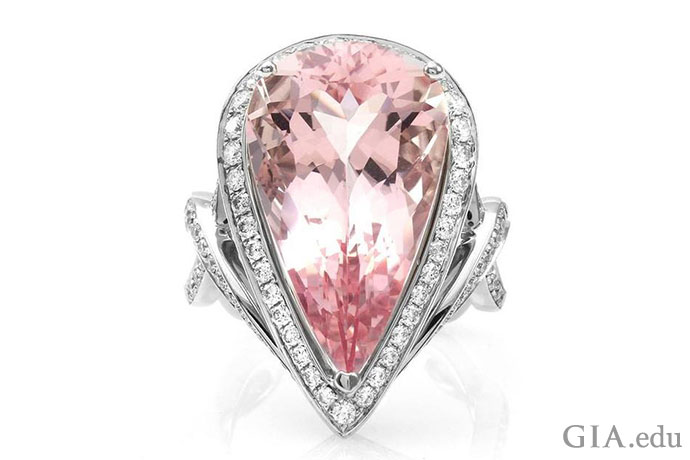 This 12.18 ct pear shaped morganite is framed by a halo of 1.06 carats of pavé diamonds.
