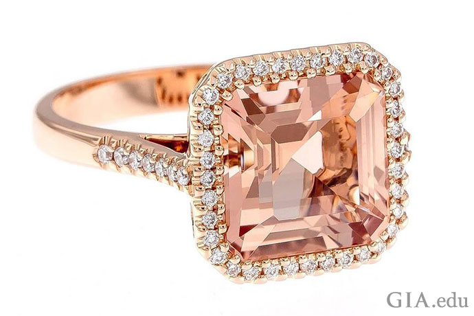 4.08 carat (ct) center stone encircled by diamonds that trail down the shank. The 18K rose gold setting accentuates the morganite's color.