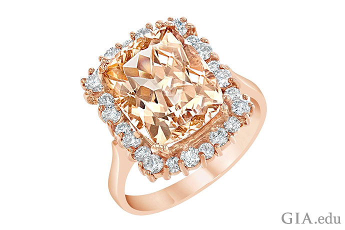 A 5.94 ct morganite is the star of this ring set in 14K rose gold with 0.70 carats of round brilliant cut diamonds.