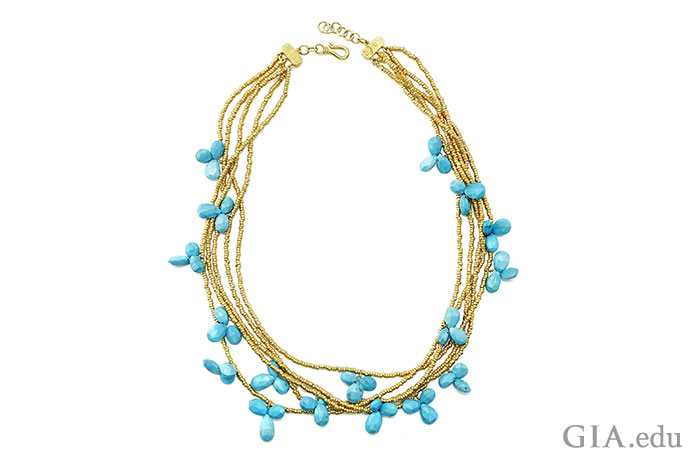 Note the even color in the clusters of turquoise dangling from gold chains in this one-of-a-kind piece.