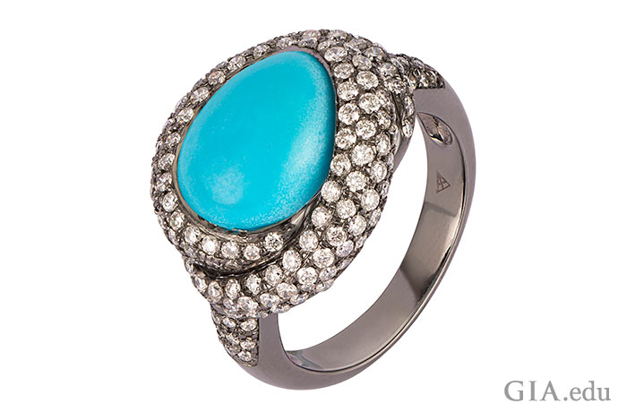 A shoreline of diamonds surround an ocean of turquoise in this captivating ring.