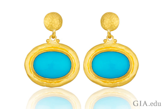 Rich blue turquoise surrounded by 24K gold makes these earrings a mesmerizing sight.