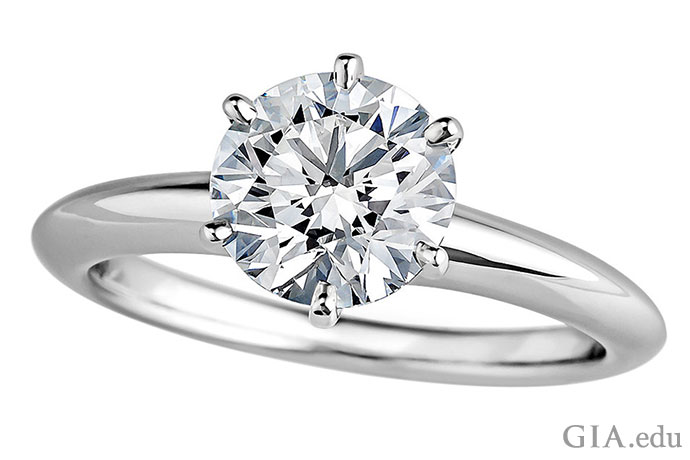 A 1.37 ct round brilliant diamond engagement ring in a six-prong setting.