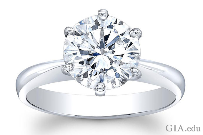 Diamond solitaire engagement ring in a six-prong platinum setting.