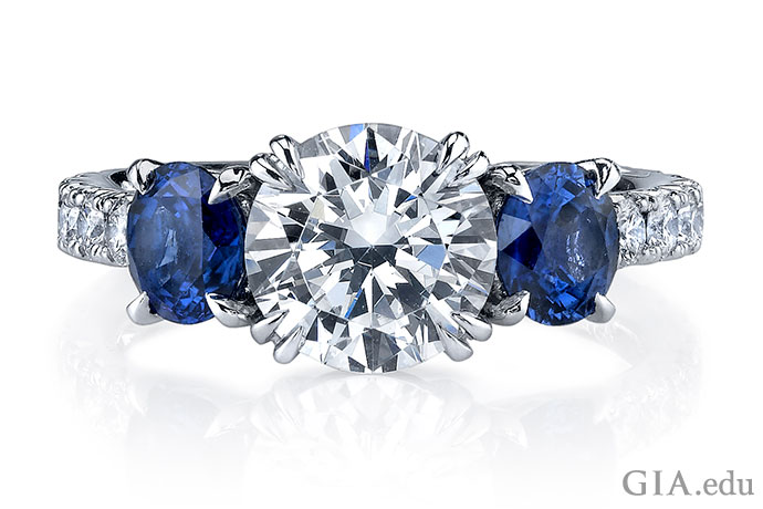 A diamond and sapphire three stone engagement ring.