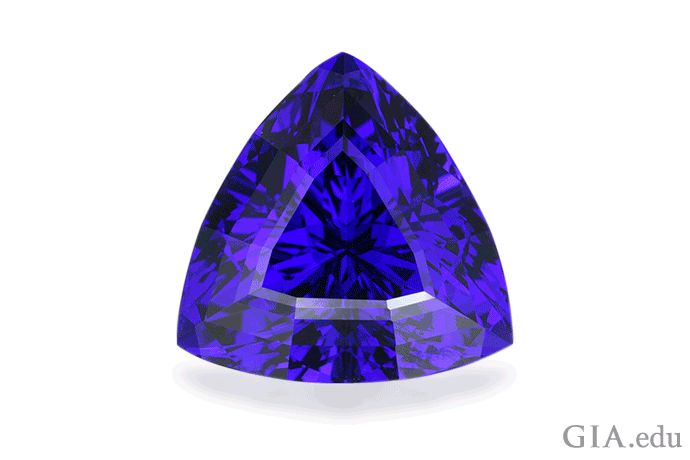 A trilliant cut tanzanite with an exceptional violetish blue color captivates as the December birthstone. Photo: Robert Weldon/GIA