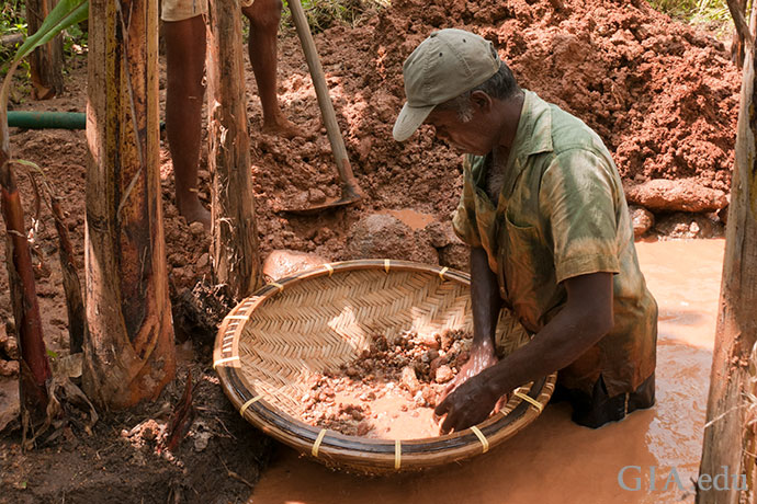 An artisanal miner searches for gems in the Elahera region of Sri Lanka.