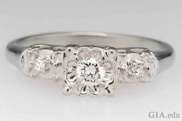 A round brilliant diamond engagement ring in an illusion setting.