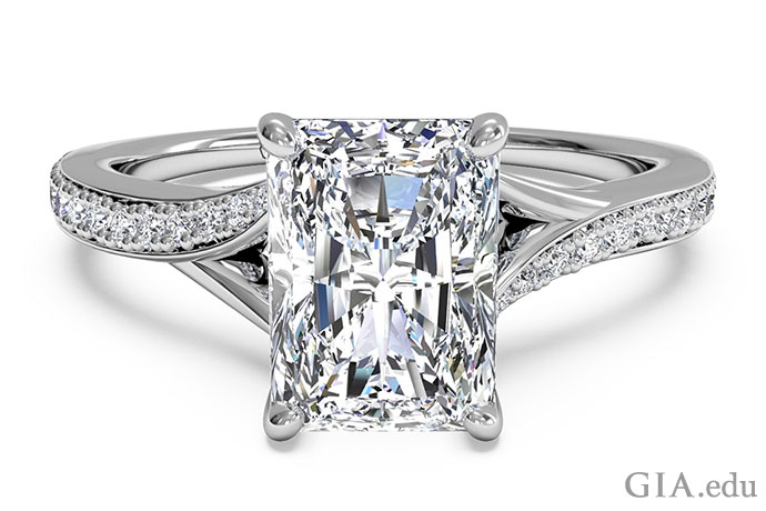 Platinum radiant cut diamond engagement ring in a bypass setting.
